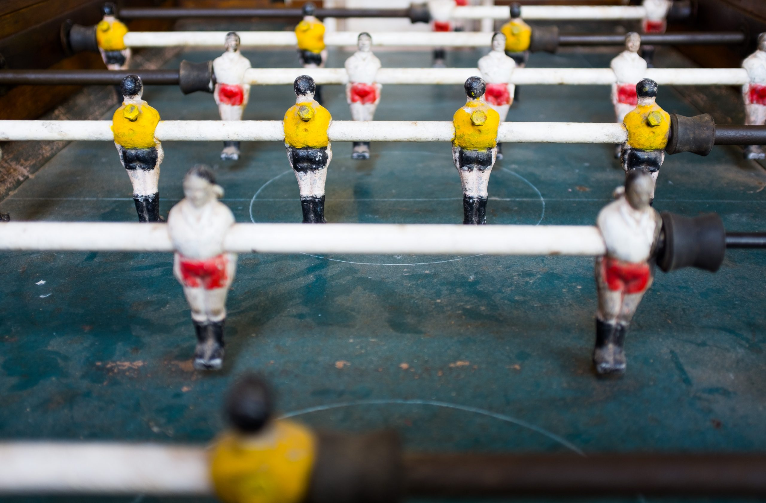 Table football players white competing against yellow