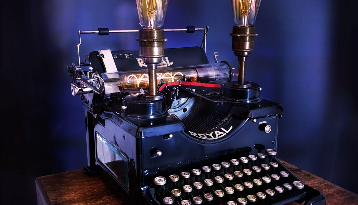 Old vintage typewriter with two bulbs attached for an SEO copywriter